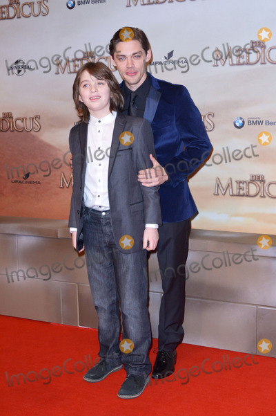 Adam Thomas Photo - Adam Thomas Wright (Actor) and Tom Payne (Actor) attending the world Premiere of the movie DER MEDICUS at Zoo Palast in Berlin Berlin 16122013 Credit Timmface to face