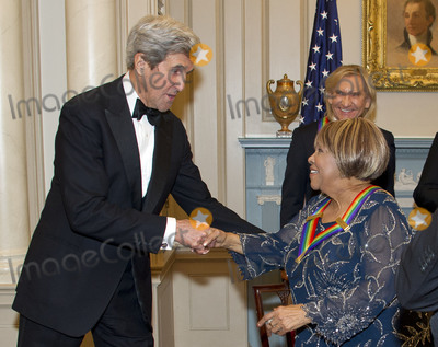 The Eagles Photo - United States Secretary of State John Kerry shakes hands with blues singer Mavis Staples one of the five recipients of the 39th Annual Kennedy Center Honors after they posed for a group photo following a dinner hosted by United States Secretary of State John F Kerry in their honor at the US Department of State in Washington DC on Saturday December 3 2016  The 2016 honorees are Argentine pianist Martha Argerich rock band the Eagles screen and stage actor Al Pacino gospel and blues singer Mavis Staples and musician James TaylorCredit Ron Sachs  Pool via CNPAdMedia