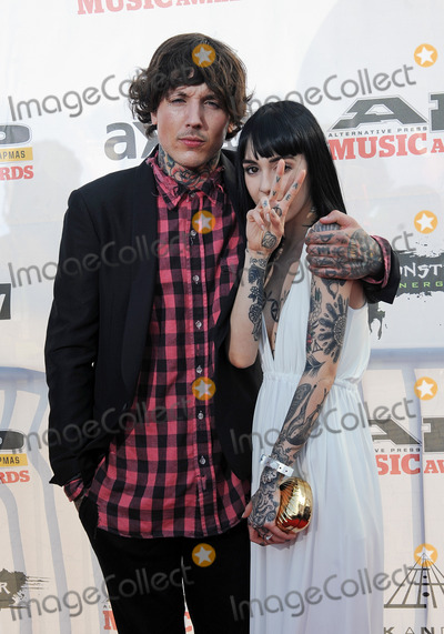 Oli Sykes Photo - 21 July 2014 - Cleveland OH - Vocalist OLI SYKES of the British band BRING ME THE HORIZON and his girlfriend HANNAH SNOWDON attend the 1st Annual 2014 Gibson Brands AP Music Awards at the Rock and Roll Hall of Fame and Museum   Photo Credit Jason L NelsonAdMedia