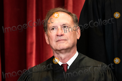 Supreme Court Photo - Associate Justice of the Supreme Court Samuel A Alito Jr sits during a group photo of the Justices at the Supreme Court in Washington DC on April 23 2021 Credit Erin Schaff  Pool via CNPAdMedia