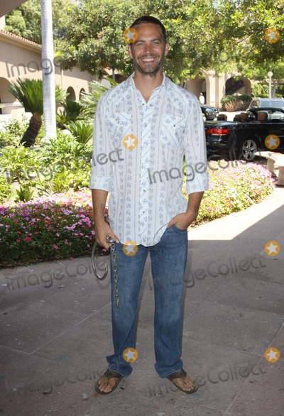 Paul Walker Photo - 30 November 2013 - Santa Clarita California - Paul Walker died at the age of 40 in a car accident while attending a charity event for his organization Reach Out Worldwide The accident occurred in Santa Clarita when Walkers Porsche lost control and crashed into a tree The car burst into flames and exploded File Photo 29 July 2009 - Pasadena California - Paul Walker 2009 Cables Summer Press Tour_Day2 Held at The Langham Huntington Hotel  Spa Photo Credit Kevan BrooksAdMedia