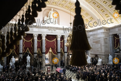Elijah Cummings Photo - Speaker of the United States House of Representatives Nancy Pelosi (Democrat of California) center left walks past the American flag-draped casket of US Representative Elijah Cummings (Democrat of Maryland) during a memorial service in National Statuary Hall at the US Capitol in Washington DC US on Thursday Oct 24 2019 Cummings a key figure in Democrats impeachment inquiry and a fierce critic of US President Donald J Trump died at the age of 68 on October 17 due to complications concerning long-standing health challengesCredit Al Drago  Pool via CNPAdMedia