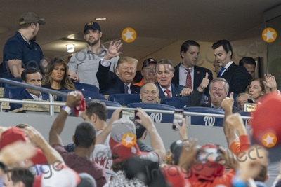 TI Photo - United States President Donald J Trump acknowledges the crowd during a moment to salute the military during game five of the World Series at Nationals Park in Washington DC on October 27 2019 The Washington Nationals and Houston Astros are tied at two games going into tonights game Among those attending with the president are US Representative John Ratcliffe (Republican of Texas) US Representative Andy Biggs (Republican of Arizona) US Representative Kevin Brady (Republican of Texas) US Senator David Perdue (Republican of Georgia) and US Representative Mark Meadows (Republican of North Carolina) Credit Chris Kleponis  Pool via CNPAdMedia
