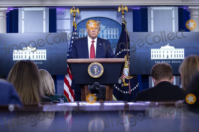 Usher Photo - United States President Donald J Trump speaks during a news conference in the James S Brady Press Briefing Room at the White House in Washington DC US on Monday August 10 2020  Trump was abruptly ushered out of the briefing room by Secret Service after shots were reportedly fired in the area  Credit Stefani Reynolds  CNPAdMedia