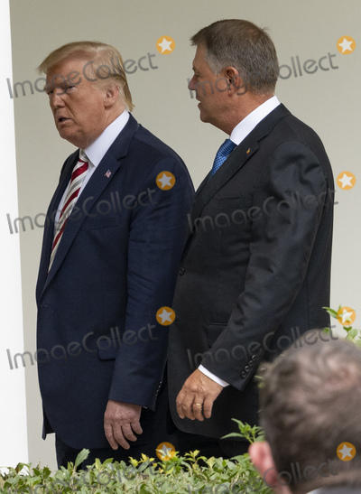 The White Photo - United States President Donald J Trump and Klaus Iohannis Romanias president during a meeting in the Oval Office of the White House in Washington DC US on Tuesday Aug 20 2019 Trump said today hes not ready to make a deal with China but adds Beijing wants an agreement and something could happen soon Photo Credit Andrew HarrerCNPAdMedia