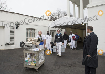 President Barack Obama Photo - Painters and workers make their way towards the the West Wing as President Barack Obama prepares to leave the White House prior to President-Elect Donald Trumps arrival in Washington DC on January 20 2017 Later today Donald Trump will be sworn-in as the 45th President Photo Credit Kevin DietschCNPAdMedia
