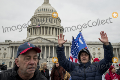 The Sounds Photo - People pray to the sound of a Bile passage over a bullhorn as a small crowd of President Trump supporters gather on the west side of the US Capitol in the hours before the Electoral votes are to be counted during a joint session of the United States Congress to certify the results of the 2020 presidential election in the US House of Representatives Chamber in the US Capitol in Washington DC on Wednesday January 6 2021 Congressional Republicans have announced they are going to challenge the Electoral votes from up to six swing statesCredit Rod Lamkey  CNPAdMedia