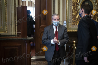 Lindsey Graham Photo - WASHINGTON DC - FEBRUARY 12 Sen Lindsey Graham R-SC walks out of a meeting room for lawyers of former President Donald Trump on the fourth day of the Senate Impeachment trials for former President Donald Trump on Capitol Hill on Friday Feb 12 2021 in Washington DC Credit Jabin Botsford  Pool via CNPAdMedia