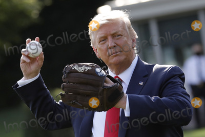 Mariano Rivera Photo - United States President Donald J Trump plays catch with Mariano Rivera the MLB Hall of Fame Closer from the Yankees to mark the Opening Day of the Major League Baseball Season on the South Lawn of the White House in Washington on July 23 2020Credit Yuri Gripas  Pool via CNPAdMedia
