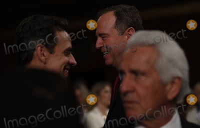 Adam Schiff Photo - US House lead impeachment manager and House Intelligence Committee Chairman Adam Schiff (D-CA) laughs with a colleague as they wait for US President Donald Trumps State of the Union address to a joint session of the US Congress in the House Chamber of the US Capitol in Washington US February 4 2020 Credit Leah Millis  Pool via CNPAdMedia