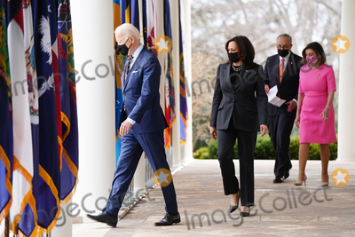 Nancy Pelosi Photo - (L-R) US President Joe Biden  Vice President Kamala Harris Senate Majority Leader Chuck Schumer and Speaker of the House nancy Pelosi arrive to deliver remarks on the American Rescue Plan from the Rose Garden of the White House in Washington DC USA 12 March 2021 President Biden signed the massive 19 trillion USD (1589 trilllion euro) coronavirus relief package into law on 11 MarchCredit Jim LoScalzo  Pool via CNPAdMedia