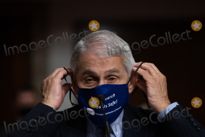 Anthony Fauci Photo - Anthony Fauci director of National Institute of Allergy and Infectious Diseases at NIH attaches his mask during a Senate Health Education and Labor and Pensions Committee on Capitol Hill in Washington Wednesday October 23 2020Credit Graeme Jennings  Pool via CNPAdMedia