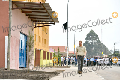 Wale Photo - 27092019 - Prince Harry Duke of Sussex walks on Princess Diana Street in Huambo Angola on day five of the royal tour of Africa The Duke is visiting the minefield where his late mother Diana Princess of Wales was photographed in 1997 which is now a busy street with schools shops and houses Photo Credit ALPRAdMedia