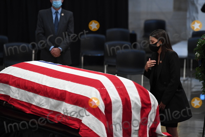 Alexandria Ocasio-Cortez Photo - United States Representative Alexandria Ocasio-Cortez (Democrat of New York) pays her respects to US Representative John Lewis (Democrat of Georgia) after the memorial service on July 27 2020 in the Rotunda of the US Capitol in Washington DCCredit Matt McClain  Pool via CNPAdMedia