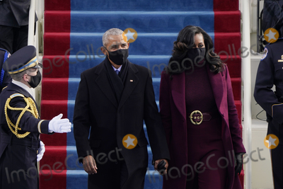 Barack Obama Photo - Former President Barack Obama and his wife Michelle arrive for the 59th Presidential Inauguration at the US Capitol for President-elect Joe Biden in Washington Wednesday Jan 20 2021 (AP PhotoPatrick Semansky Pool)AdMedia