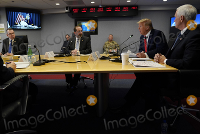 Alex Azar Photo - United States President Donald J Trump second from right speaks during a teleconference with governors at the Federal Emergency Management Agency headquarters Thursday March 19 2020 in Washington DC US Vice President Mike Pence is at right and Department of Health and Human Services Secretary Alex Azar is third from rightCredit Evan Vucci  Pool via CNPAdMedia