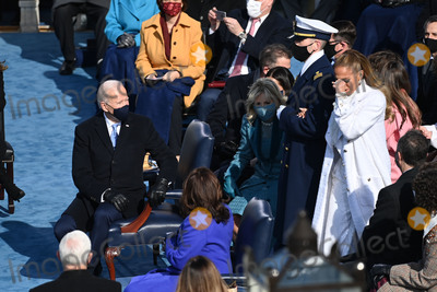 JENNIFER LOPEZ Photo - US Singer Jennifer Lopez arrives to sing at the Inauguration ceremony of the 46th US President on January 20 2021 at the US Capitol in Washington DC - Biden a 78-year-old former vice president and longtime senator takes the oath of office at noon (1700 GMT) on the US Capitols western front the very spot where pro-Trump rioters clashed with police two weeks ago before storming Congress in a deadly insurrection (Photo by Saul LOEB  POOL  AFP)AdMedia