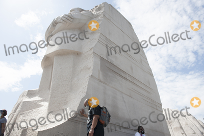 Martin Luther King Photo - A man pauses in the extreme Summer heat at the base of the Martin Luther King Jr Memorial following the Get Your Knee Off Our Necks March on Washington at the Lincoln Memorial in Washington DC Friday August 28 2020 Credit Rod Lamkey  CNPAdMedia