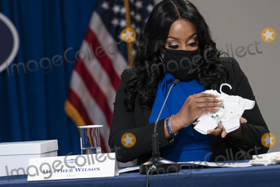 Kennedy Photo - Heather Wilson Executive Director and Founder of Kennedys Angel Gowns holds clothing for deceased babies during a roundtable discussion on Black maternal health hosted by Vice President Kamala Harris and White House Domestic Policy Advisor Susan Rice in the South Court Auditorium in Washington DC US on Tuesday April 13 2021  Credit Sarah Silbiger  Pool via CNPAdMedia