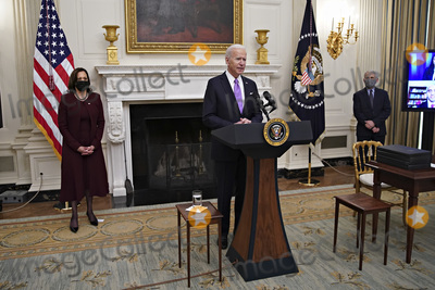 Anthony Fauci Photo - US President Joe Biden speaks as US Vice President Kamala Harris left and Anthony Fauci director of the National Institute of Allergy and Infectious Diseases right listen during an event on his administrations Covid-19 response in the State Dining Room of the White House in Washington DC US on Thursday Jan 21 2021 Biden in his first full day in office plans to issue a sweeping set of executive orders to tackle the raging Covid-19 pandemic that will rapidly reverse or refashion many of his predecessors most heavily criticized policies Photographer Al DragoBloombergCredit Al Drago  Pool via CNPAdMedia