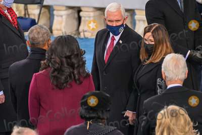 First Lady Michelle Obama Photo - Outgoing US Vice President Mike Pence (C) and US Second Lady Karen Pence meet Former US President Barack Obama (L) and Former US First Lady Michelle Obama (2nd L) before US President-elect Joe Biden is sworn in as the 46th US President on January 20 2021 at the US Capitol in Washington DC - Biden a 78-year-old former vice president and longtime senator takes the oath of office at noon (1700 GMT) on the US Capitols western front the very spot where pro-Trump rioters clashed with police two weeks ago before storming Congress in a deadly insurrection (Photo by Saul LOEB  POOL  AFP)AdMedia