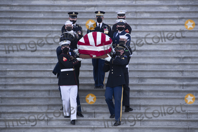 The Used Photo - The casket of US Capitol Police Officer William Evans is carried by a joint service honor guard down the East Front steps of the US Capitol after lying in honor in the Capitol Rotunda in Washington DC USA 13 April 2021 A Tribute and Lying in Honor Ceremony took place for Officer Evans who was killed and another officer injured in the line of duty when a suspect rammed a vehicle at the North entrance of the Capitol 02 AprilCredit Michael Reynolds  Pool via CNPAdMedia
