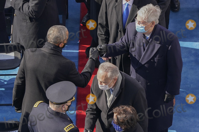 President Barack Obama Photo - Former President Barack Obama left greeting Senator Mitch McConnell of R-Ky right after attending the 59th Presidential Inauguration at the US Capitol in Washington Wednesday Jan 20 2021 (AP PhotoSusan Walsh Pool)AdMedia