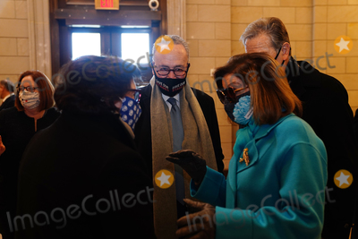 Nancy Pelosi Photo - Speaker of the House Nancy Pelosi (R) and Senate Minority Leader Chuck Schumer (2L) before President-elect Joe Biden arrives at the East Front of the US Capitol for his inauguration ceremony to be the 46th President of the United States in Washington DC USA 20 January 2021AdMedia