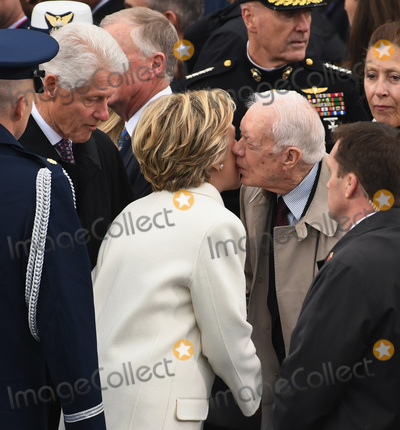 Jimmy Carter Photo - Former President Jimmy Carter kisses Hillary Clinton on the cheek as she and former President Bill Clinton arrive for the Inauguration Ceremony of President Donald Trump on the West Front of the US Capitol on January 20 2017 in Washington DC  Trump became the 45th President of the United States Photo Credit Kevin DietschCNPAdMedia