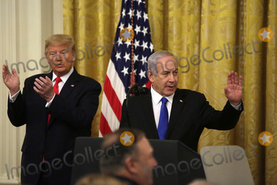 Benjamin Netanyahu Photo - United States President Donald J Trump applauds Israels Prime Minister Benjamin Netanyahu acknowledges guest during a meeting in the East Room of the White House in Washington DCon Tuesday January 28 2020 Credit Joshua Lott  CNPAdMedia