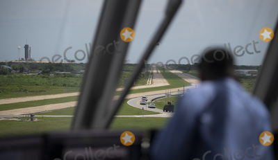 THE WINDOW Photo - In this photo released by the National Aeronautics and Space Administration (NASA) Tthe convoy carrying NASA astronauts Robert Behnken and Douglas Hurley is seen through the windows of firing room four as it makes its way to Launch Complex 39A ahead of the launch of NASAs SpaceX Demo-2 mission Saturday May 30 2020 in the Launch Control Center at NASAs Kennedy Space Center in Florida NASAs SpaceX Demo-2 mission is the first launch with astronauts of the SpaceX Crew Dragon spacecraft and Falcon 9 rocket to the International Space Station as part of the agencys Commercial Crew Program The test flight serves as an end-to-end demonstration of SpaceXs crew transportation system Behnken and Hurley are scheduled to launch at 322 pm EDT on Saturday May 30 from Launch Complex 39A at the Kennedy Space Center A new era of human spaceflight is set to begin as American astronauts once again launch on an American rocket from American soil to low-Earth orbit for the first time since the conclusion of the Space Shuttle Program in 2011 Mandatory Credit Joel Kowsky  NASA via CNPAdMedia