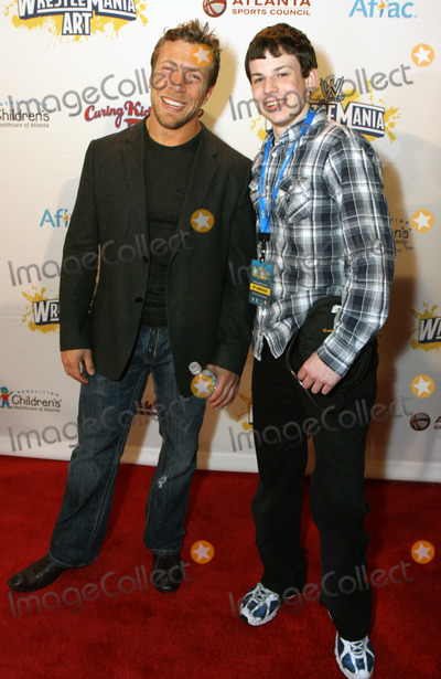 Daniel Bryan Photo - March 30 2011 - Atlanta GA - WWE superstar Daniel Bryan and Childrens Hospital patient Bradley Rogers walked the red carpet for the Wrestlemania Art Show at the Fox Theater Photo Dan HarrAdMedia