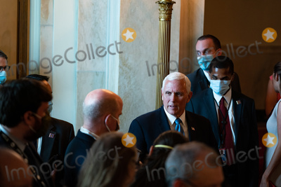 Mike Pence Photo - United States Vice President Mike Pence arrives during a news conference in the Cross Hall of the White House in Washington DC US on Wednesday July 8 2020 President Lopez Obrador has carefully built a rapport with President Trump even as the president lambasted Mexico for its drug cartels and crime rates for migration flows into the US and for allegedly taking advantage of America on trade Credit Anna Moneymaker  Pool via CNPAdMediaAdMedia