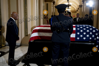 Will Rogers Photo - United States Representative John Lewis (Democrat of Georgia) pays his respects to US Representative Elijah Cummings (Democrat of Maryland) as Cummings lies in state outside of the House Chamber in the Will Rogers corridor of the US Capitol in Washington DC on October 24th 2019  Credit Anna Moneymaker  Pool via CNPAdMedia