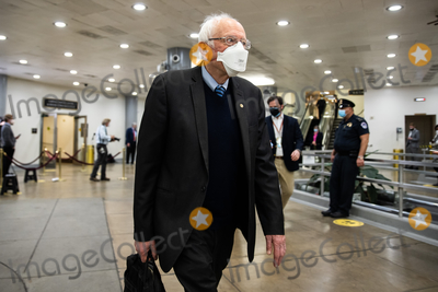 Bernie Sanders Photo - Senator Bernie Sanders I-VT walks on Capitol Hill in Washington Saturday Feb 13 2021 on the fifth day of the second impeachment trial of former President Donald TrumpCredit Graeme Jennings - Pool via CNPAdMedia