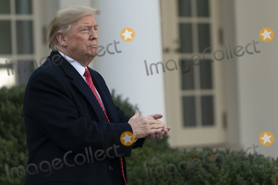 The National Photo - United States President Donald J Trump applauds after he and first lady Melania Trump presented the National Thanksgiving Turkey in the Rose Garden of the White House in Washington DC on Tuesday November 26 2019Credit Chris Kleponis  Pool via CNPAdMedia