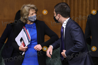 Pete Buttigieg Photo - WASHINGTON DC - APRIL 20 United States Senator Lisa Murkowski (Republican of Alaska) (L) greets US Secretary of Transportation Pete Buttigieg before a Senate Appropriations Committee hearing in the Dirksen Senate Office Building on Capitol Hill on April 20 2021 in Washington DC Members of President Bidens cabinet are testifying about the American Jobs Plan the administrations 23 trillion infrastructure plan that has yet to win over a single Republican in Congress Credit Chip Somodevilla   Pool via CNP