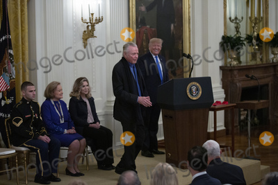 Jon Voight Photo - Jon Voight dances as United States President Donald J Trump introduces him during an East Room ceremony where he awarded Voight as well as Allison Krauss Sharon Percy Rockefeller the Musicians of the United States Military the Claremont Institute Theresa Lozano Long Patrick J OConnell and James Patterson the National Medal of Arts and the National Humanities Medal at the White House in Washington DC US on Thursday November 21 2019Credit Stefani Reynolds  CNPAdMedia