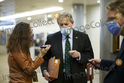 Kennedy Photo - United States Senator John Neely Kennedy (Republican of Louisiana) wears a protective mask while talking with members of the press in the Senate Subway at the US Capitol in Washington DC US on Thursday Feb 11 2021 House prosecutors used the second day of Donald Trumps impeachment trial to detail a months-long campaign by the former president to stoke hatred and encourage violence over the election results that they said culminated in the mob attack on the US Capitol that he then did little to stop Credit Ting Shen - Pool via CNPAdMedia