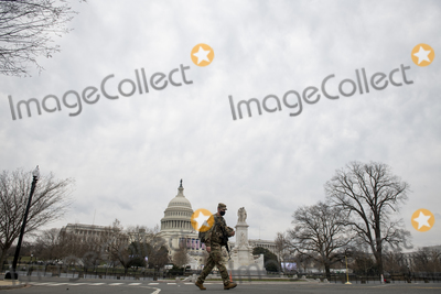 The National Photo - A member of the National Guard walks past the US Capitol as preparations are made for the upcoming inauguration of President Joe Biden at the US Capitol in Washington DC Friday January 15 2021 Credit Rod Lamkey  CNPAdMedia