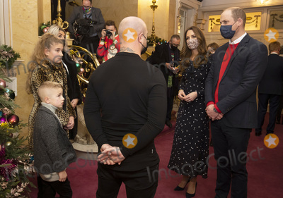 Kate Middleton Photo - Photo Must Be Credited Alpha Press 073074 11122020Prince William Duke of Cambridge and Kate Duchess of Cambridge Catherine Katherine Middleton talks to Dom Warren and family Dom is the founder of Doms Food Mission as they attend a special pantomime performance at Londons Palladium Theatre hosted by The National Lottery to thank key workers and their families for their efforts throughout the pandemic No UK Rights Until 28 Days from Picture Shot Date