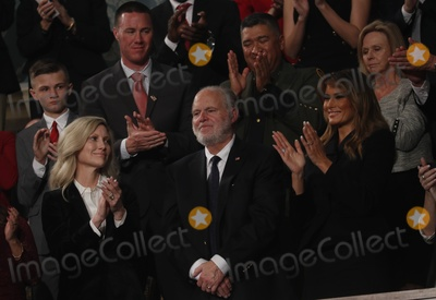 Donald Trump Photo - FILE PHOTO Radio personality Rush Limbaugh is honored by US President Donald Trump with a Presidential Medal of Freedom as he stands with first lady Melania Trump during the State of the Union address to a joint session of the US Congress in the House Chamber of the US Capitol in Washington US February 4 2020 Credit Leah Millis  Pool via CNPAdMedia
