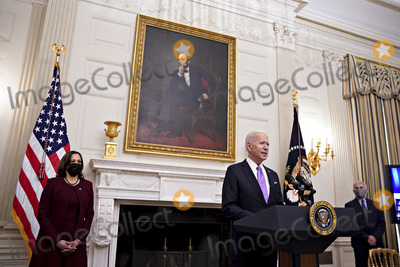Anthony Fauci Photo - US President Joe Biden speaks as US Vice President Kamala Harris left and Anthony Fauci director of the National Institute of Allergy and Infectious Diseases right listen during an event on his administrations Covid-19 response in the State Dining Room of the White House in Washington DC US on Thursday Jan 21 2021 Biden in his first full day in office plans to issue a sweeping set of executive orders to tackle the raging Covid-19 pandemic that will rapidly reverse or refashion many of his predecessors most heavily criticized policies Credit Al Drago  Pool via CNPAdMedia