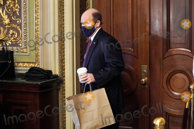 President Trump Photo - Sen Chris Coons (D-Del) accidentally tries to have lunch in the room where attorneys for former President Donald Trump are meeting in as the Senate takes a short recess on the fifth day of the impeachment trial of former President Trump on Saturday February 13 2021Credit Greg Nash - Pool via CNPAdMedia