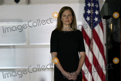 Supremes Photo - Judge Amy Coney Barrett listens to United States President Donald J Trump as she waits to take her oath of office as Associate Justice of the Supreme Court on the South Lawn of the White House in Washington DC on Monday October 26 2020Credit Chris Kleponis  Pool via CNPAdMedia