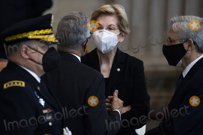 US Army Photo - UNITED STATES - APRIL 13 From right United States Attorney General Merrick Garland US Senator Elizabeth Warren (Democrat of Massachusetts) US Representative Bobby Scott (Democrat of Virginia) and US Army General Mark A Milley Chairman of the Joint Chiefs of Staff attend the service for US Capitol Officer William Billy Evans as his remains lie in honor in the Capitol Rotunda in Washington DC on Tuesday April 13 2021 Evans was killed when a driver rammed the north barricade of the Capitol on April 2 2021 Credit Tom Williams  Pool via CNPAdMedia