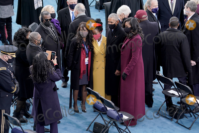 Barack Obama Photo - Amanda Gorman center takes a photo with former president Barack Obama and Michelle Obama prior to the 59th Presidential Inauguration on Wednesday January 20 2021 at the US Capitol in Washington DCAdMedia