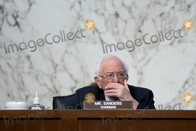 Bernie Sanders Photo - United States Senator Bernie Sanders (Independent of Vermont) listens during a US Senate Budget Committee hearing at the Hart Senate Office Building on Capitol Hill in Washington DC US on Thursday March 25 2021 Credit Stefani Reynolds  CNPAdMedia