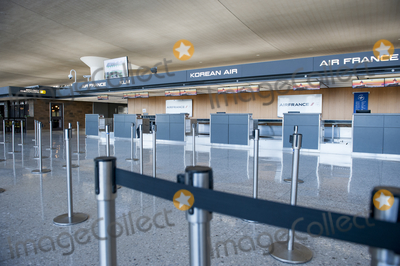 The Interns Photo - The morning hours are quiet at the international terminal at Dulles International Airport in Dulles Va Monday March16 2020 Some people are taking the precaution of wearing face masks as they arrive to be greeted by family and or friends Credit Rod Lamkey  CNPAdMedia