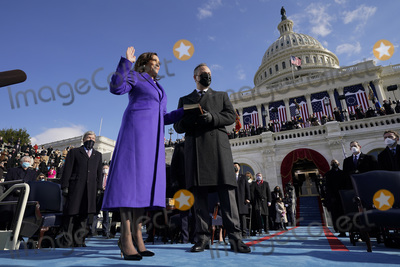 Supreme Court Photo - Kamala Harris is sworn in as Vice President by Supreme Court Justice Sonia Sotomayor as her husband Doug Emhoff holds the Bible during the 59th Presidential Inauguration at the US Capitol in Washington Wednesday Jan 20 2021 (AP PhotoAndrew Harnik Pool)AdMedia